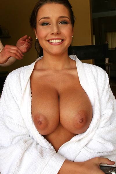Busty Erica Campbell shows off her big tits behind the scenes for your delight