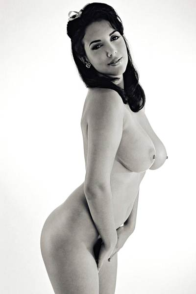 Jelena Jensen strips in black and white showing off her huge tits