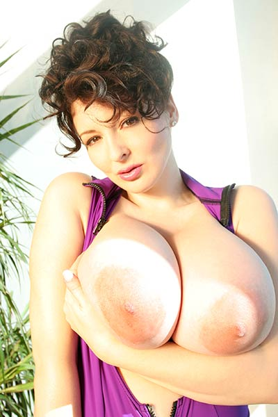 Naughty brunette shows off her big tits and firm ass for your delight