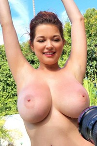 Naughty Tessa Fowler reveals her lush tits in a candy stripe bikini