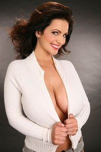 Denise Milani gets frisky exposing her tight ass and titties for your delight