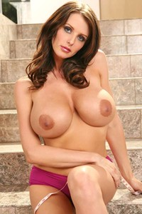 Busty Brandy Robbins shows off her big tits at home for your pleasure