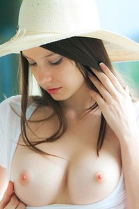 Rylee Marks playfully slips off her shirt and cups her small breasts