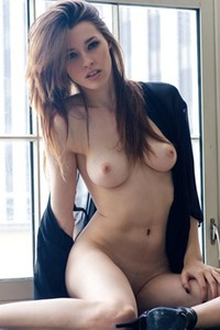 Caitlin McSwain lets her sheer robe fall open to reveal her skinny naked body