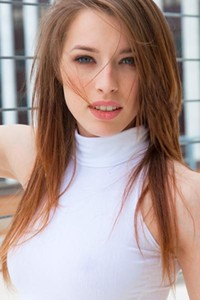 Caitlin McSwain pulls up her bra and pulls down her panties on the roof