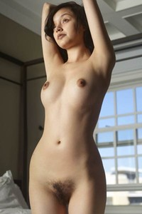 Black haired seductress Eden flaunts her nice firm tits for a photo shoot