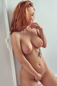 Adorable and playful charmer Vos bares her smoking hot body in Redhead Beauty