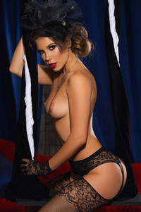 Stunning busty babe Gia Ramey Gay flaunts her fabulous curves in sexy black lingerie
