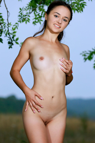 Petite girl Jennifer Hart bares her irresistible young and sexy body in the outdoor photo shoot