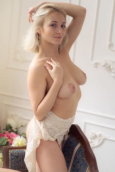 Sexy blonde Isabella D slips her top down to expose her natural big titties