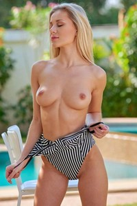 Stunning blonde Candice B with her perfectly shaped body poses seductively by the pool
