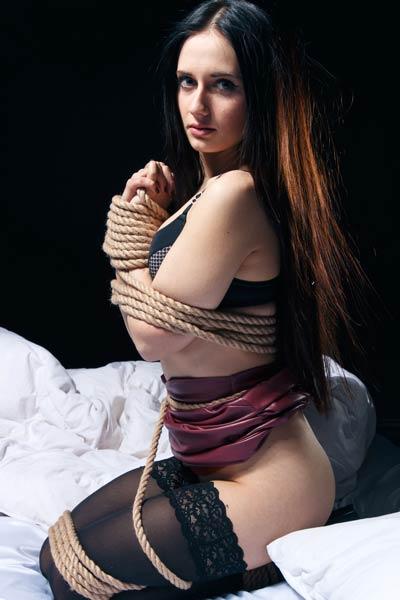 Ravishing hottie in tight stockings Eva Kahil in a kinky photoshoot