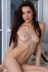 A very slim and unbelievably sexy chick is showcasing her magnificent naked body