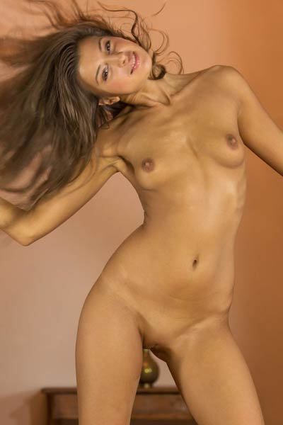 Melena A enjoys teasing her fans with her tanned sexy naked body