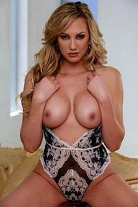 Curly blonde Brett Rossi flaunts her massive tits and shaved pussy