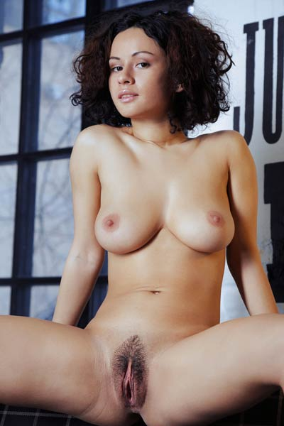 Pammie Lee shows off her perfect big melons and hairy yummy vag