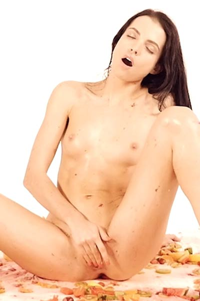 Fabulous brunette Sapphira gets her body covered with fruits and she looks so delicious