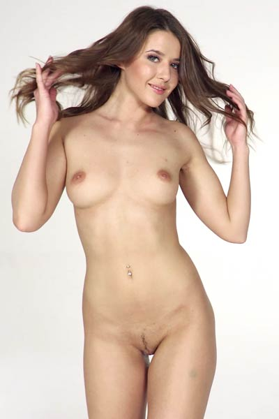 Sybil toys with her wet vag as she prepares for a photo shoot