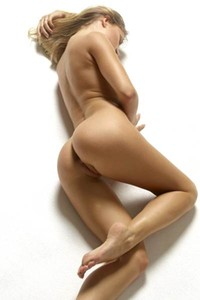 Fantastic blonde lays on the floor and rolss up in various poses to show us her hot body