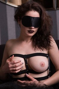 Busty bombshell in stockings Judith Able is blindfolded while she strips