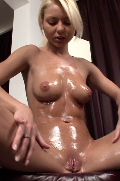 Fantastic blonde oils up her sexy body completely before she starts pleasuring her muff with toys