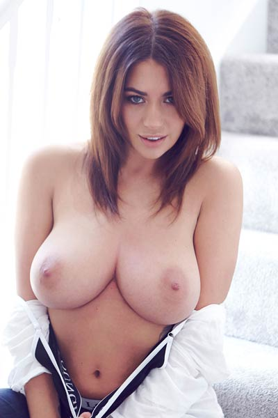 Fantastic brunette with massive tits Holly Peers strips down and displays her burning hot ass