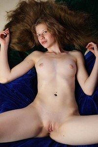 Natural redhead flaunts her pink vag and her small pink nipples for a photo shoot