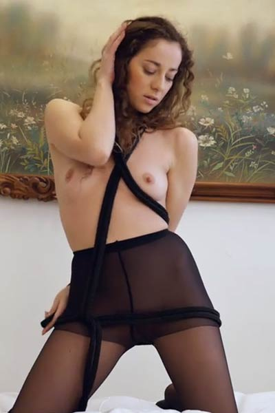 Horny babe Louisa A tears apart her black stockings as she masturbates intensively
