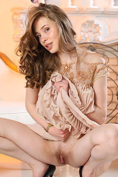 Mesmerizing brunette babe slowly undresses baring her body of a goddess
