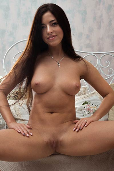 Hot brunette takes off her warm sweater and poses in nude only for your nasty mind