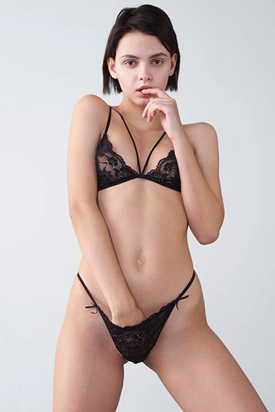 Ariel slowly drops her sexy black lingerie and displays her yummy clam