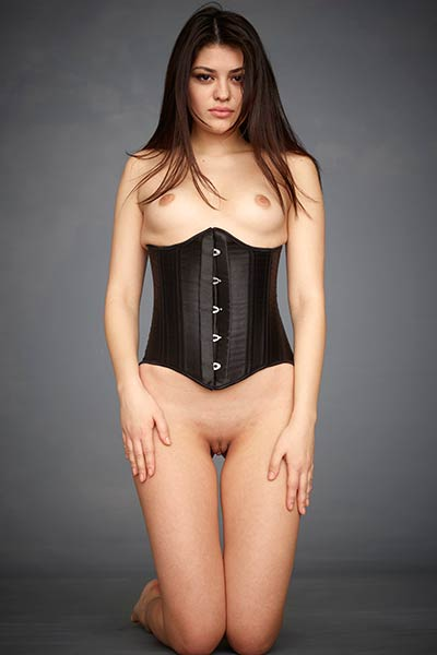 The black corset that she is wearing highlights her yummy perky boobs