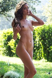 Hot slender babe Mila Blaze poses in the garden and presents her pure sexiness