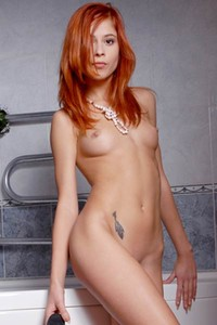Are you ready to get wet and naughty with this cute skinny redhead girl