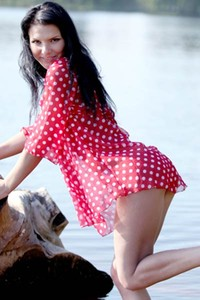 Sexy brunette spreads her legs and reveals her sweet pussy in shallow water