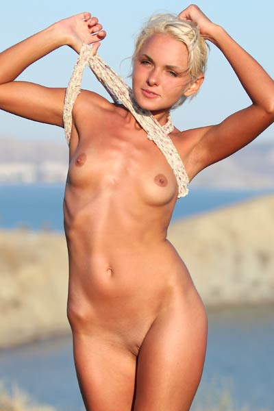 Check out this skinny blonde with small breasts posing in nude on the lonely place