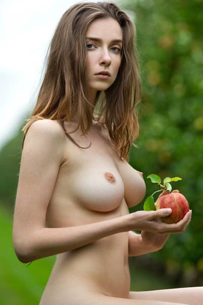 Sweet and sexy brunette poses naked in the fruit field and bares her delicious body