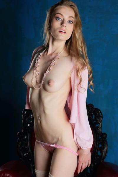 Blue eyed charmer Rebecca G strips her sexy pink panties and bares her hot peachy ass