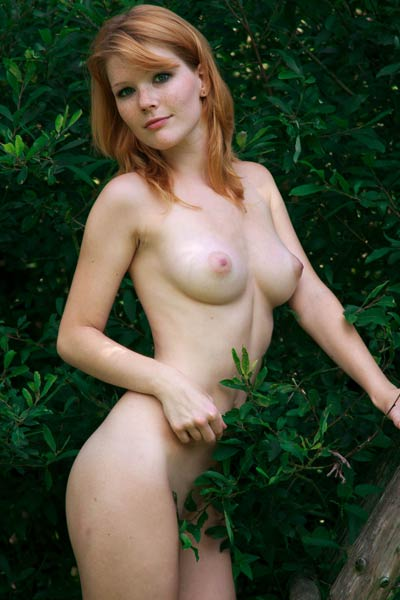 Mesmerizing ginger babe poses naked in the forest barn and presents her perfect body and wild spirit