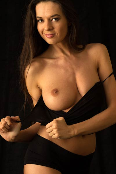 Underneath that black top Niky hides her perfectly shaped boobs with small dark nipples