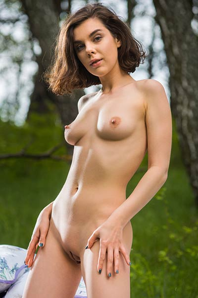 Charming and cute dame Dakota A presents her perfect body outdoor