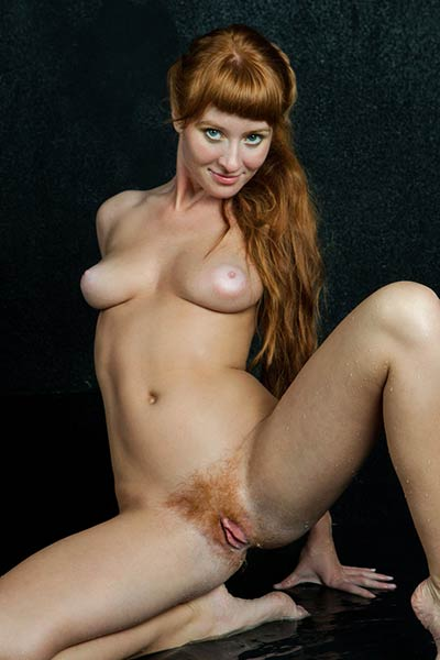 Ginger cutie with fine looking tits Brisa spreads her legs giving you a view of her hairy cunt