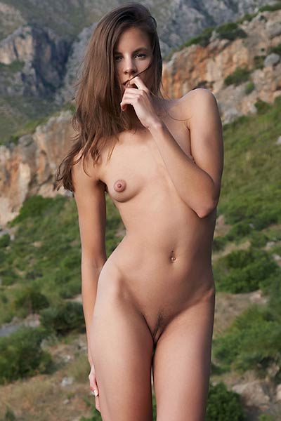 Pretty brunette babe Antea gets nude outdoor and presents her hot petite body
