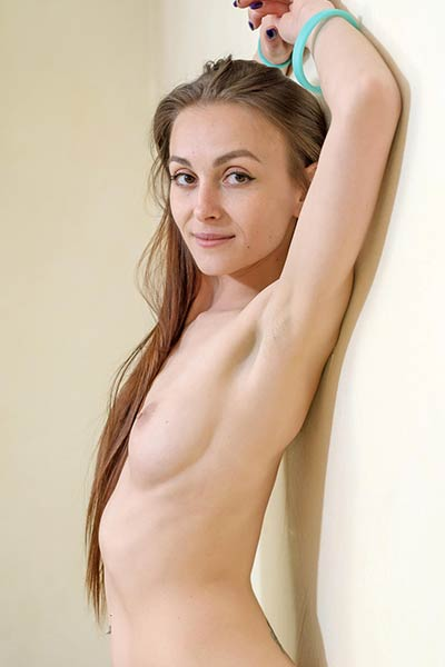 Petite brunette Selin presents her blooming naked body