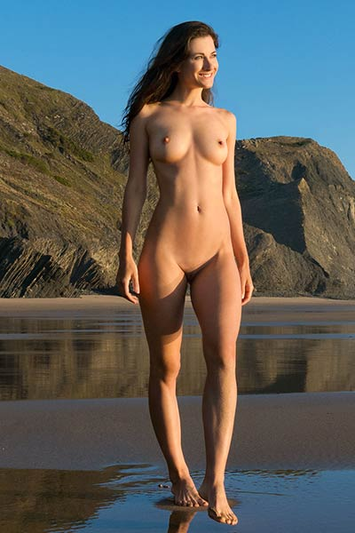 Graceful damsel poses naked on the beach and dazzles us with her hot tan lines