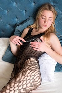 Gorgeous blonde babe is home alone so she is giving herself relax with a huge dildo