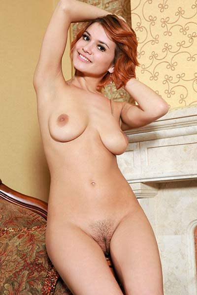 Hot redhead vixen spreads her legs in sexy stockings to show us her juicy snatch