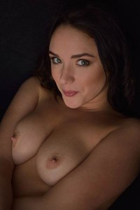 Alluring vixen Nika A enjoys being naked and posing in front of a camera