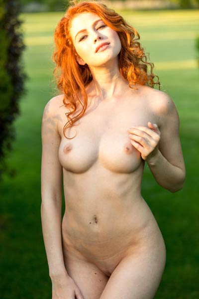 This redhead has such a nice pair of natural firm boobs and delicious round ass