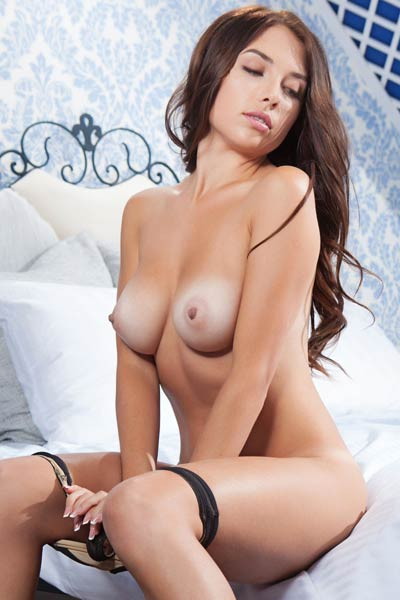 A confident brunette babe Niemira seductively poses naked and presents her sexy tan lines